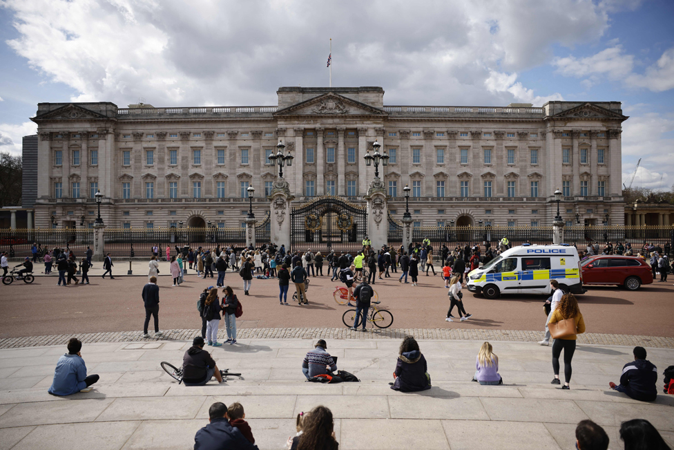 People gather outside Buckingham Palace following the death of Prince Philip
