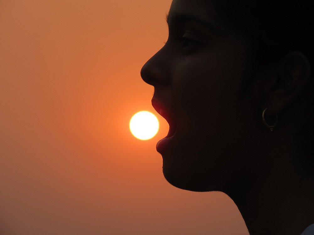 Woman 'eating' the sun