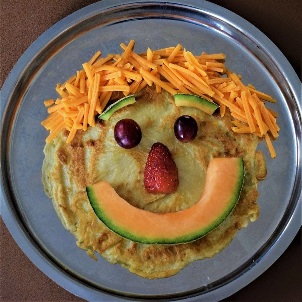 Pancake with a face of fruit