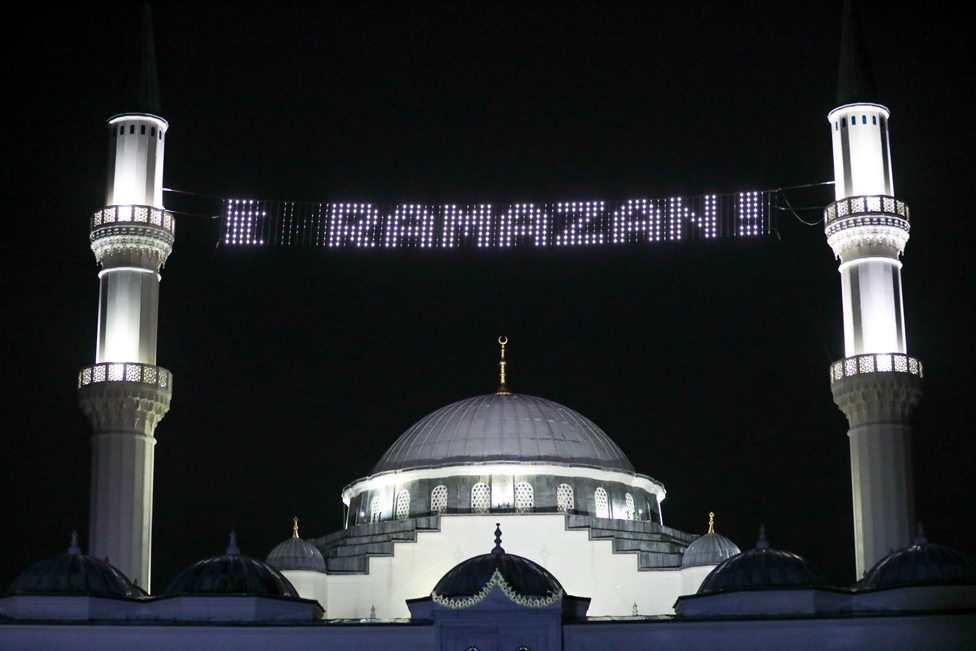 A mosque with an electronic sign saying Ramazan
