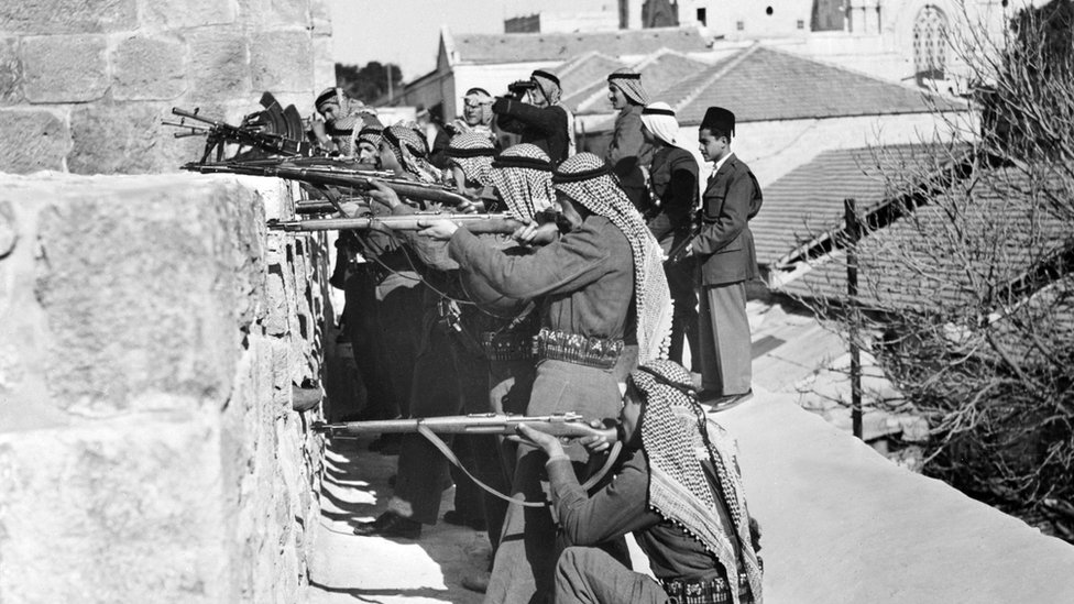 The soldiers of allied Arab Legion forces fire, 06 March 1948 from East sector of Jerusalem on Jewish fighters of the Haganah, the Jewish Agency self-defence force, based in Jemin Moshe quarter of the West sector of the city during during the first Arab-Jewish conflict.