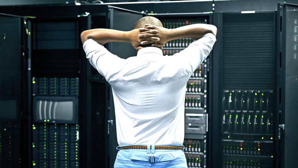 Man upset looking at servers