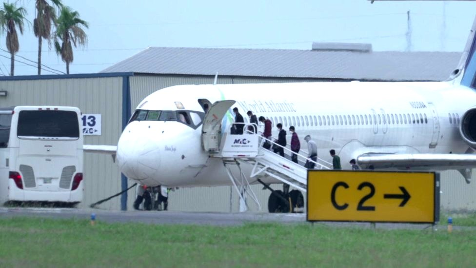 A plane being loaded with migrant children