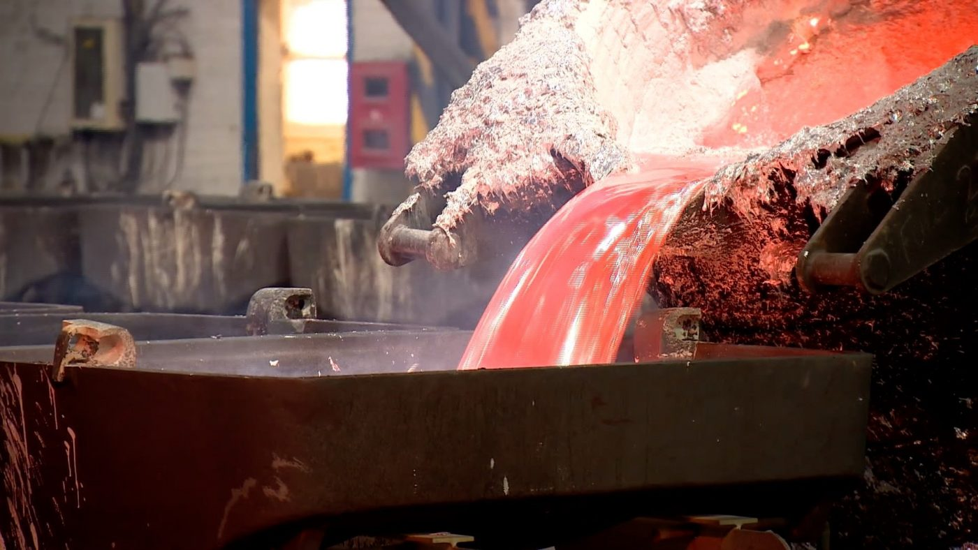 Molten aluminium is poured into a mould at the Fort William power plant