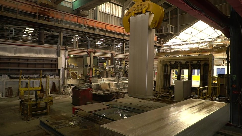 An eight tonne bar of aluminium being lifted by a crane