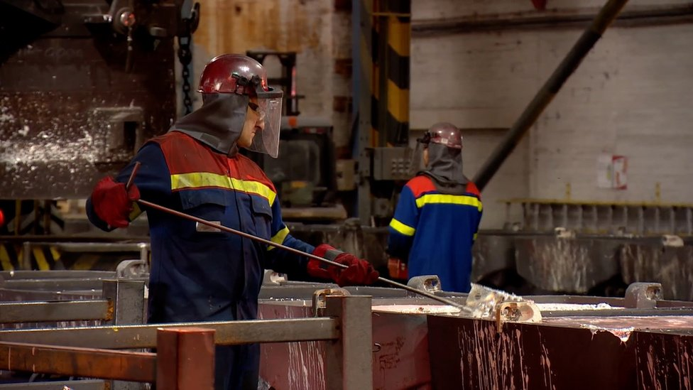 Workers at the Fort William aluminium smelter