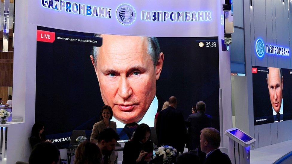 President Vladimir Putin is seen on a screen in St Petersburg, Russia, June 4, 2021