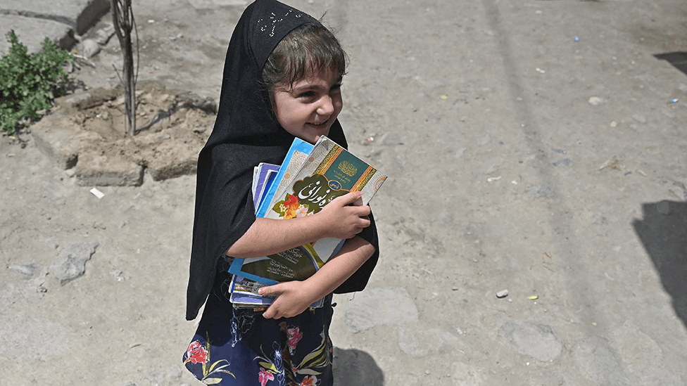 Girl with books in Kabul on 12 July