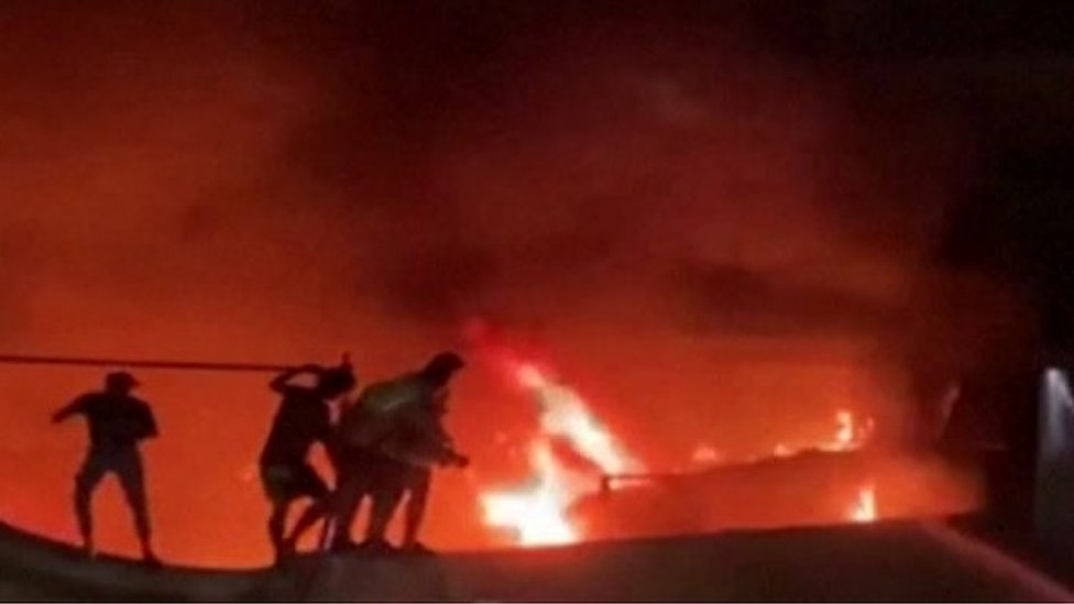 Civil defence forces tackle a fire at a hospital in the southern Iraqi city of Nasiriya
