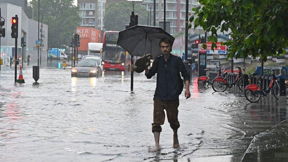 Pedestrian walking through floodwater