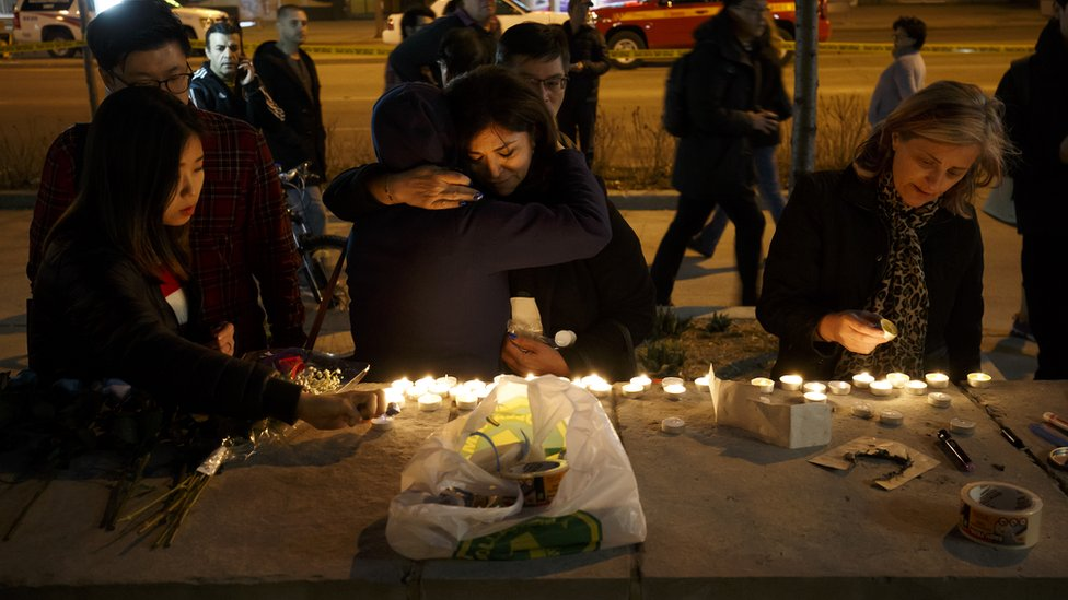 Mourners leave candles and messages on Yonge Street after the attack