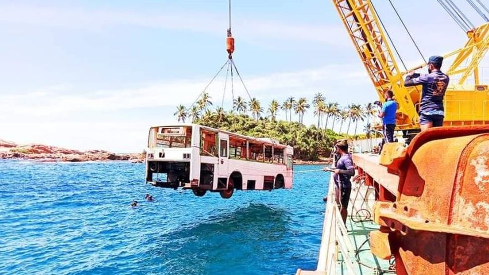 A bus is being lowered into sea