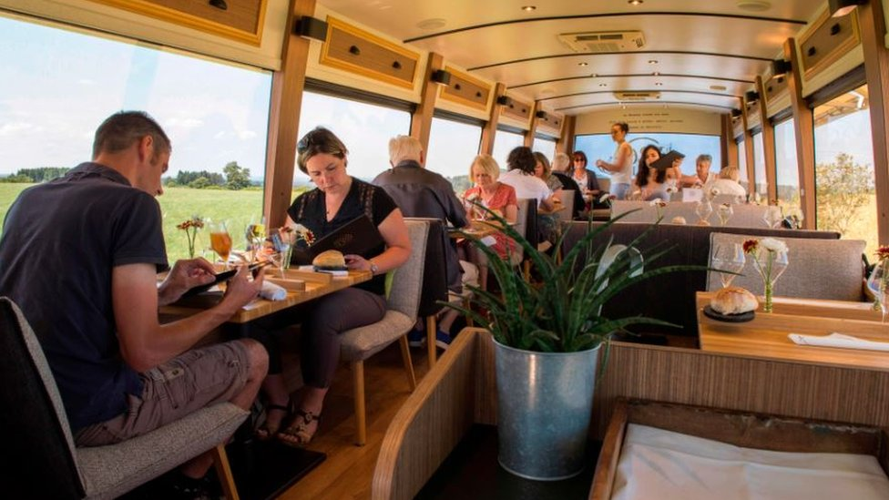 Clients eat aboard the itinerant gourmet restaurant in Pulverieres in central France