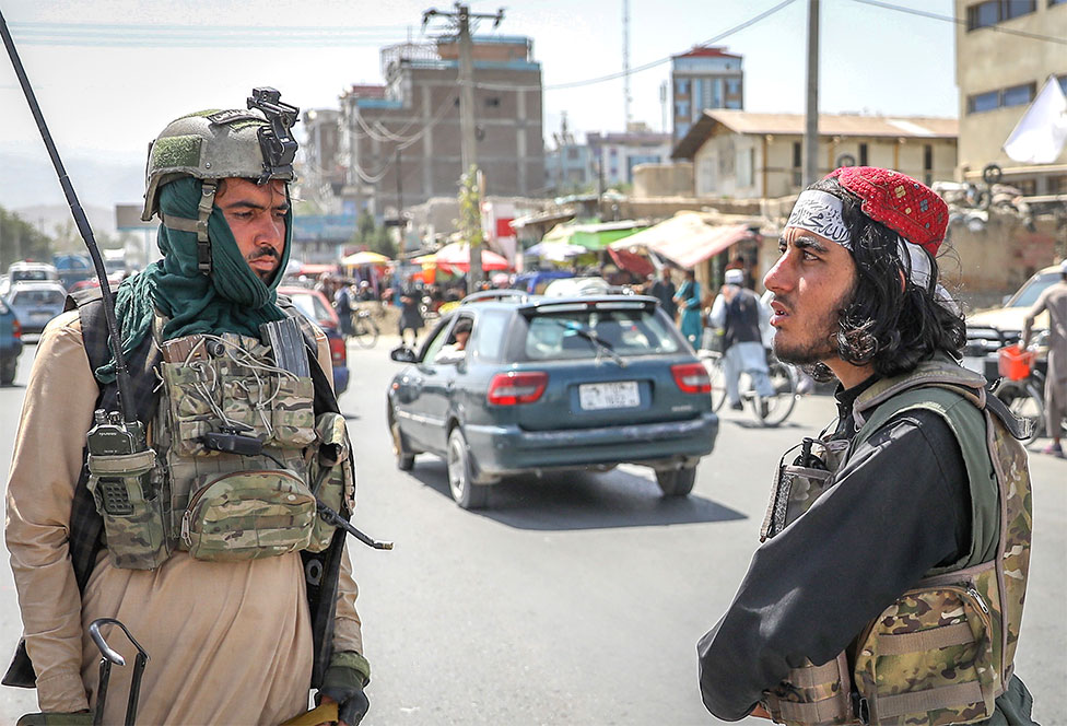 Members of the Taliban stand in a checkpoint in Kabul, Afghanistan, 16 August 2021
