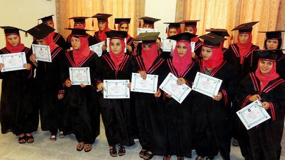 Afghan nurses showing their graduation certificate