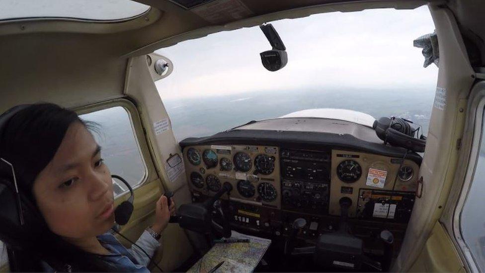 Noor in a cockpit
