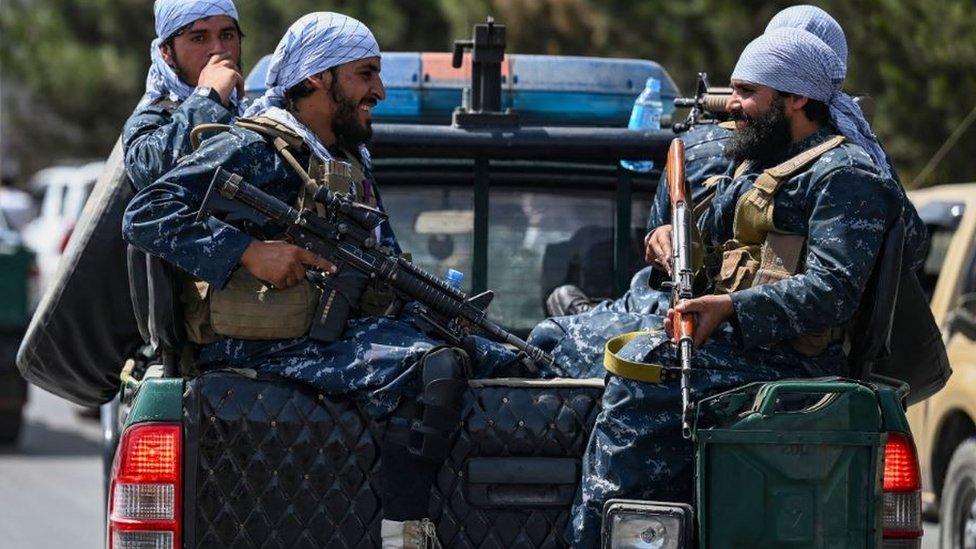 Taliban militants on patrol