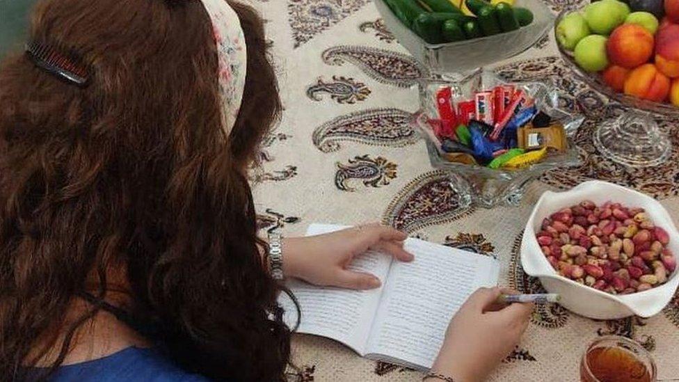 Mahsa writing a note