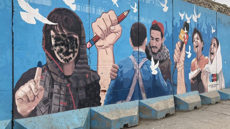 A defaced mural in Kabul depicting women's right, peace and freedom of expression