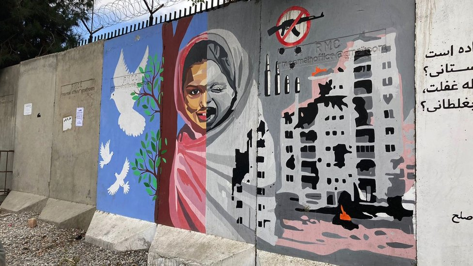 A mural painting depicting a girl's face - happy in times of peace, and shattered in times of war