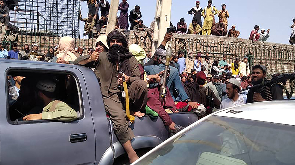 Taliban fighters sit on a vehicle in Jalalabad province, August 15 2021
