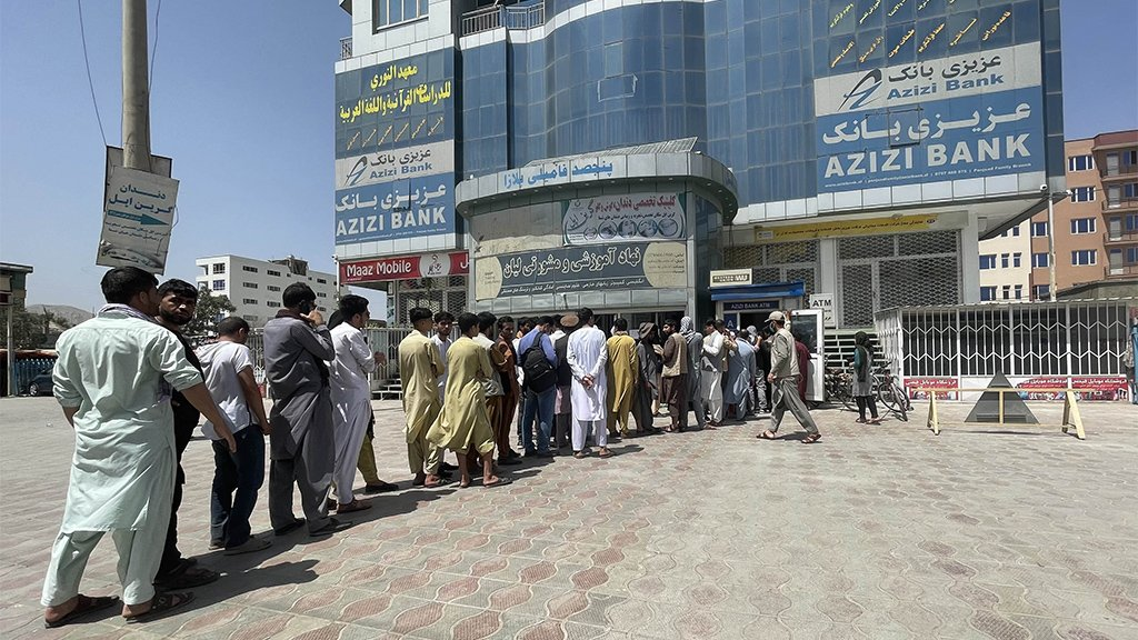 Afghan people queue up outside Azizi Bank in Kabul, August 15 2021