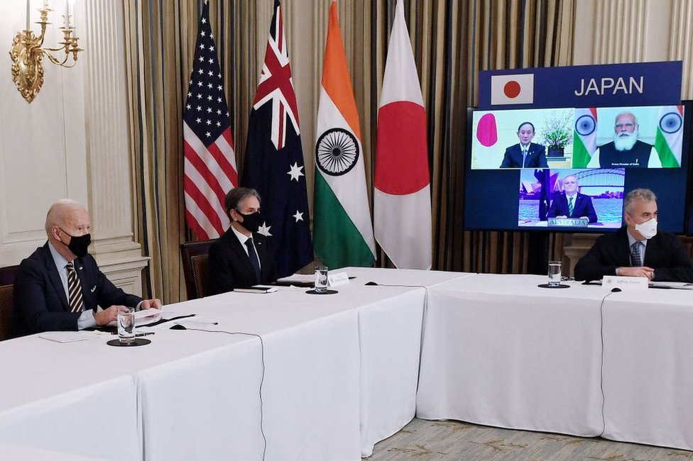 US President Joe Biden (L), with Secretary of State Antony Blinken (2nd L), meets virtually with members of the