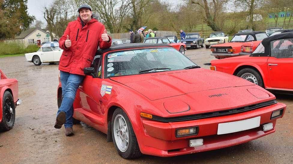 Wayne Scott with his red Triumph TR8